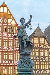famous lady justice in Frankfurt under blue sky