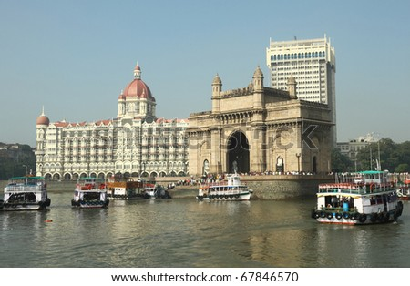 Famous landmarks of Bombay - Gate of India and Taj Mahal Hotel - seen from the sea, India