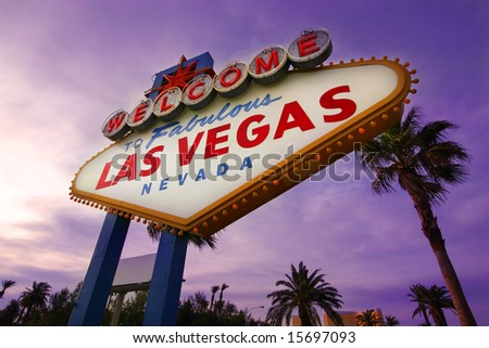 Famous Las Vegas Welcome Sign at sunset with palm trees in the background - stock photo