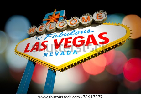 Famous Las Vegas Welcome Sign at sunset with palm trees in the background