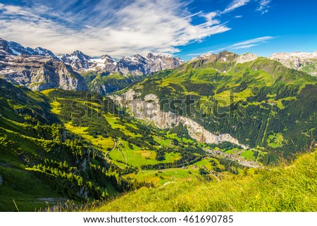 Famous Lauterbrunnen valley with gorgeous waterfall and Swiss Alps in the background from Mannlichen, Berner Oberland, Switzerland, Europe. #461690785
