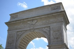 Famous marble Roman triumphal arch at Greenwich Village's popular Washington Square Park in Lower Manhattan, New York City