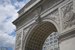 Famous marble Roman triumphal arch landmark in Washington Square Park near Greenwich Village, Manhattan, NYC