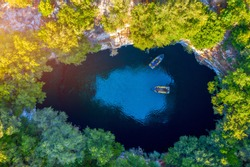 Famous Melissani lake on Kefalonia island, Karavomylos, Greece. On top of Melissani Cave (Melissani Lake) in Karavomylos village in Kefalonia island , Greece. Melissani Cave viewed from above.