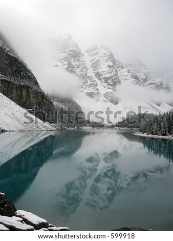 famous moraine lake in canada after a snow storm