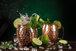 Famous Moscow mule alcoholic cocktail in copper mugs, close-up.