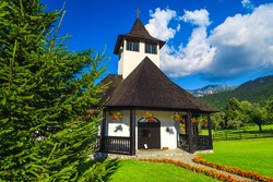 Famous mountain monastery and decorated entrance with colorful flowers, Bran, Transylvania, Romania, Europe