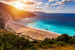 Famous Myrtos beach from overlook, Kefalonia (Cephalonia), Greece. Myrtos beach, Kefalonia island, Greece. Beautiful view of Myrtos beach, Ionian Island, Kefalonia (Cephalonia), Greece.