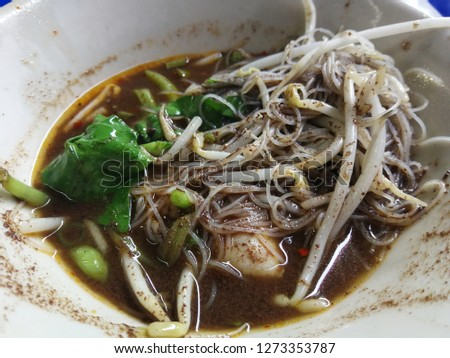 Famous of Thailand noodle that Noodle in Thicken Soup with Sliced Pork or  Beef Braised Beef and Pork or Beef Ball