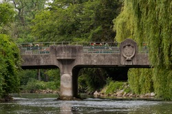 Famous old stone bridge with engraved city arms over the river Amper in the bavarian town Fuerstenfeldbruck on cloudy overcast day