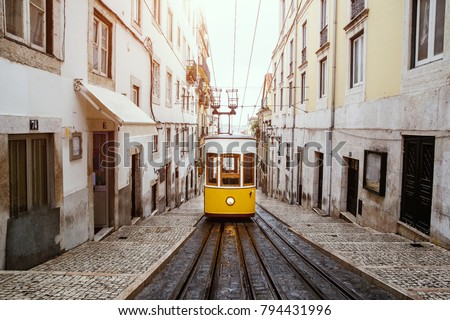 Famous old yellow tram on street of Lisbon, Lisboa, Funicular