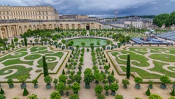 Famous palace Versailles with beautiful gardens and fountains from top. The Palace Versailles was a royal chateau. It was added to the UNESCO list of World Heritage Sites. Paris, France.