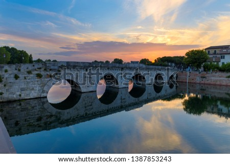 Famous place in Rimini, Italy. Tiberius Bridge in the late evening. #1387853243