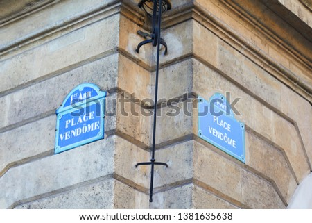 Famous Place Vendome corner with street signs in Paris, France #1381635638