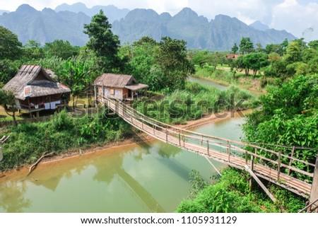 Famous Place, wooden village in Vang Vieng, Laos  #1105931129