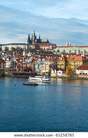 Famous Prague castle over river Vltava, View of Prague city skyline viewed over the river with castle and Saint Vitus Cathedral