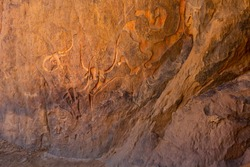 Famous rock relief carving  of a crying cow at Tegharghart,   near Djanet, Tassili nAjjer National Park, South Algeria, North Africa,