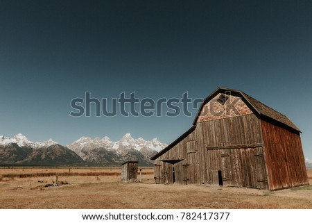 Famous rustic barn in Mormon Row Historic District with Grand Tetons in distance