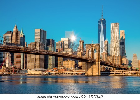 Famous Skyline of downtown New York, Brooklin Bridge and  Manhattan at the early morning sun light , New York City, USA #521155342