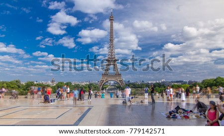 Shutterstock Famous square Trocadero with Eiffel tower in the background. Trocadero and Eiffel tower are the most visited attractions of Paris. Blue cloudy sky at summer day