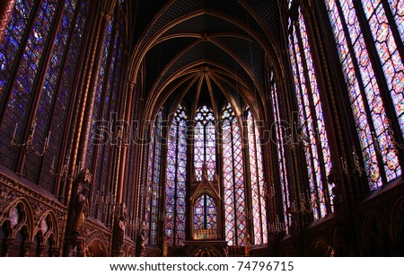 Famous stained glass windows and ceiling within La Sainte-Chapelle Chapel in Paris, France