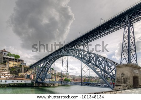Famous steel bridge dom Luis above connects Old town Porto with Vila Nova de Gaia at river Douro, Portugal