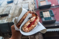 Famous street food in Naples - pizza margherita