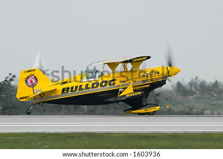 Famous stunt biplane, piloted by Jim LeRoy, on the runway taking off