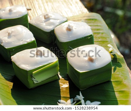 Famous Thai Pudding with Coconut topping called Khanom Tako, Thai pudding with coconut topping, Thai dessert, Khanom Tako on banana leaf. #1528238954