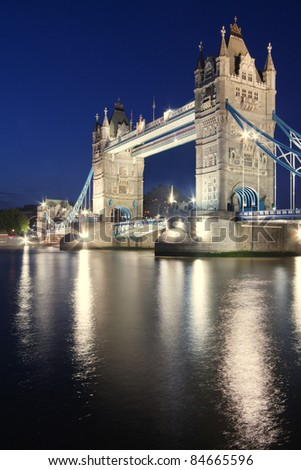 Famous Tower Bridge in London at dusk - Thames river on foreground