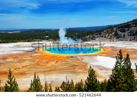 Famous trail of Grand Prismatic Springs in Yellowstone National Park from high angle view. Beautiful  hot springs with vivid color blue green orange in Wyoming.