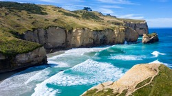 Famous Tunnel beach in New Zealand, DUNEDIN, NEW ZEALAND Popular tourist attraction in Dunedin, South island of New Zealand, amazing coast line from above, Cliff formations at Tunnel Beach