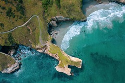 Famous Tunnel beach in New Zealand, DUNEDIN, NEW ZEALAND Popular tourist attraction in Dunedin, South island, amazing coast line from above with a drone, Cliff formations at Tunnel Beach