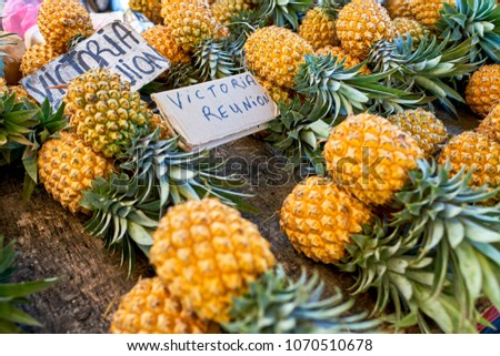 famous victoria pineapple on local market of reunion island #1070510678