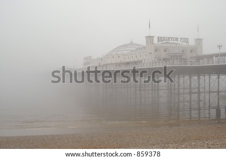 Famous Victorian Palace Pier in Brighton, East Sussex, UK, in the morning fog