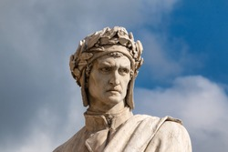 Famous white marble monument of Dante Alighieri by  Enrico Pazzi in Piazza Santa Croce, next to Basilica of Santa Croce, Florence, Italy