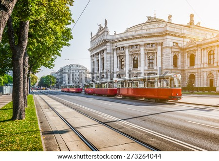 Famous Wiener Ringstrasse with historic Burgtheater (Imperial Court Theatre) and traditional red electric tram at sunrise with retro vintage Instagram style filter effect in Vienna, Austria Stock photo ©