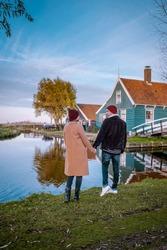 famous windmill village Zaanse schans, historical windmill village near Amsterdam Netherlands couple visit the village