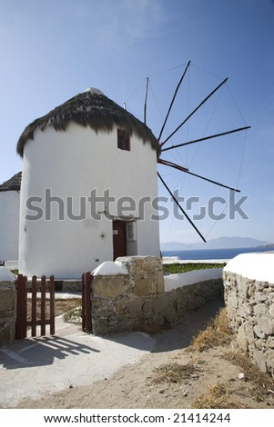 famous windmills in harbor of mykonos island greece