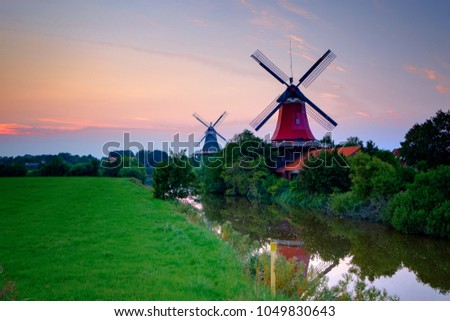 Famous windmills of Greetsiel/Germany at sunset