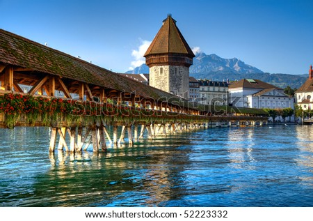 Famous wooden bridge in Lucerne Switzerland. - stock photo