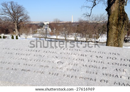 Famous words of President John F. Kennedy at the Arlington National Cemetery in Virginia, with the Washington Monument in the background.