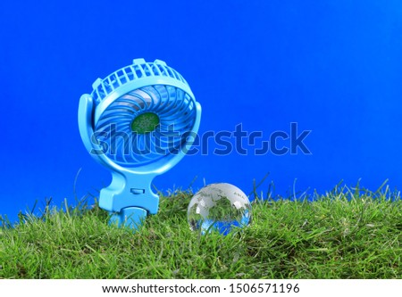 Fan cooling cools the globe, global warming concept