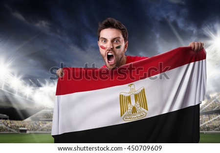 Fan holding the flag of Egypt #450709609