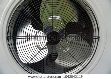 Fan is an electrically powered machine to make people feel cooler. #1043843119