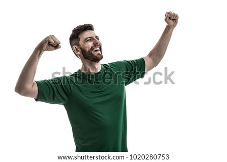 Shutterstock Fan / Sport Player on green uniform celebrating
