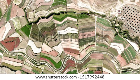 fan, tribute to Picasso, abstract photography of the Spain fields from the air, aerial view, representation of human labor camps, abstract art,