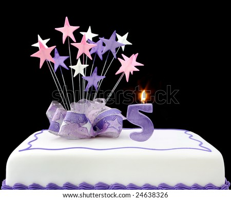 Fancy cake with number 5 candle.  Decorated with ribbons and star shapes, in pastel tones over black background.