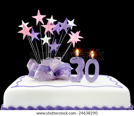 Fancy cake with number 30 candles.  Decorated with ribbons and star-shapes, in pastel tones on black background.