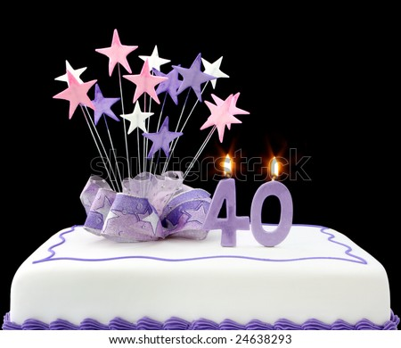 Fancy cake with number 40 candles.  Decorated with ribbons and star-shapes, in pastel tones on black background.